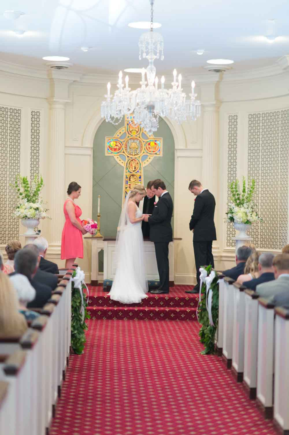 couple praying at altar when getting married