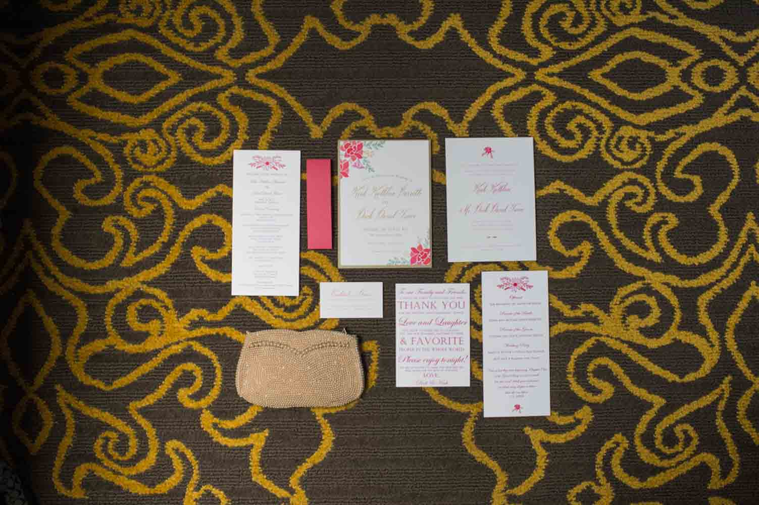 colorful wedding invitations on carpet