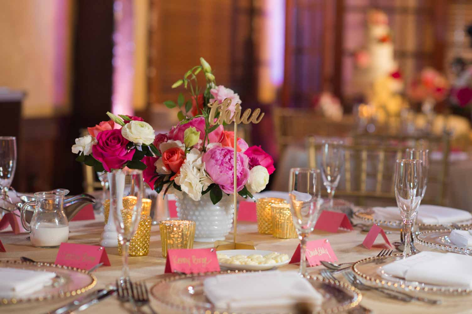 vibrant floral wedding centerpiece on tan linens