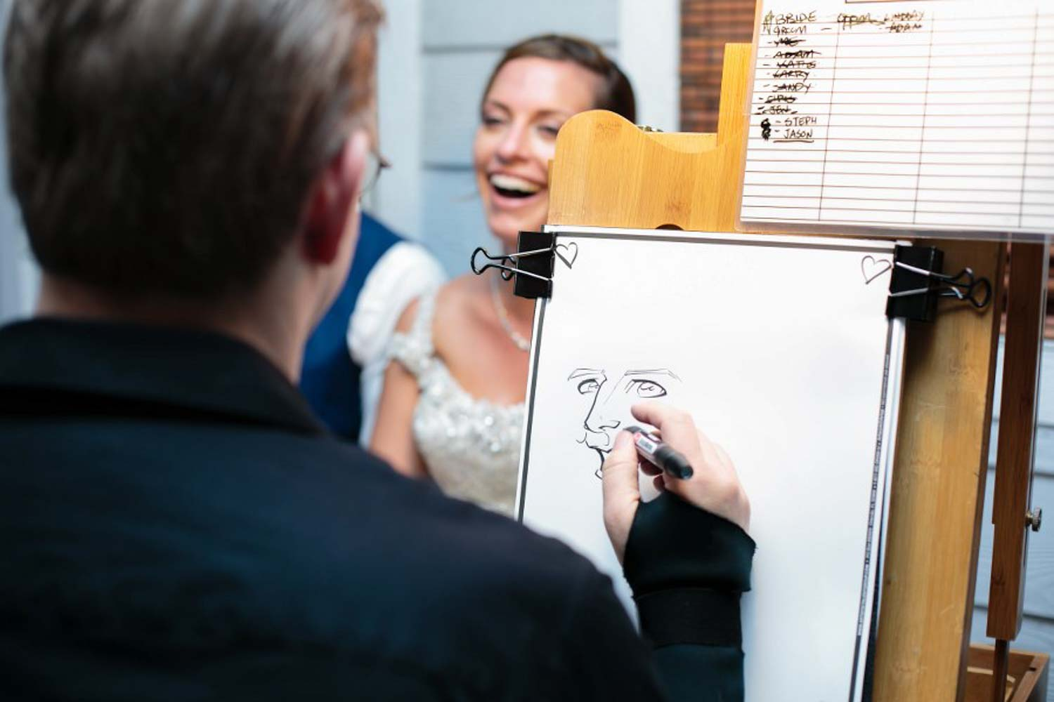 bride smiling while getting a caricature done