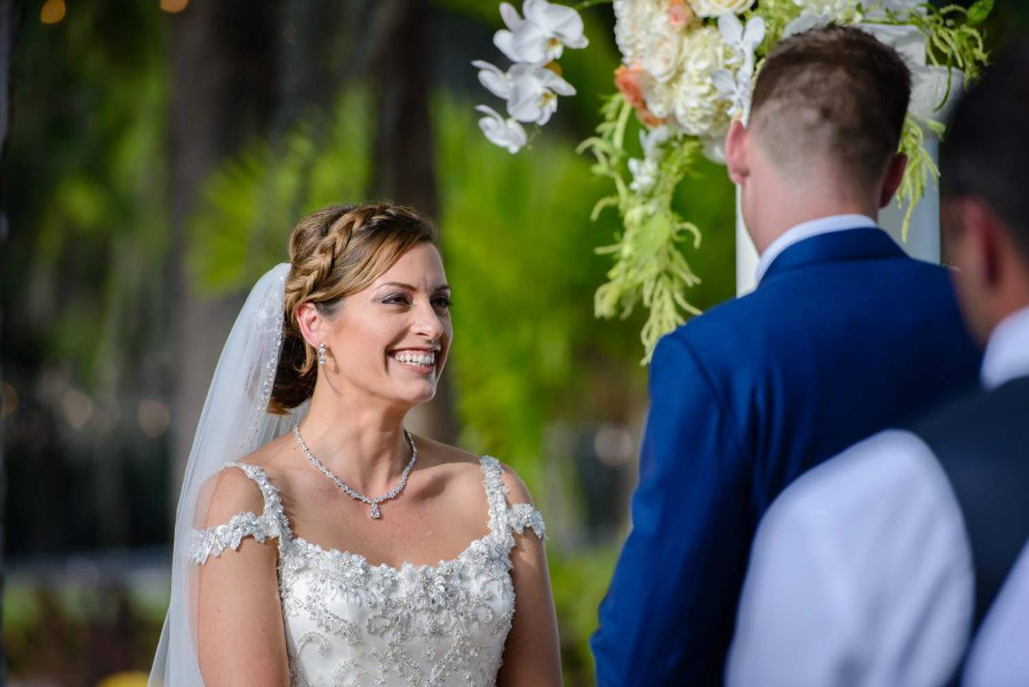 bride smiling at groom while saying wedding vows