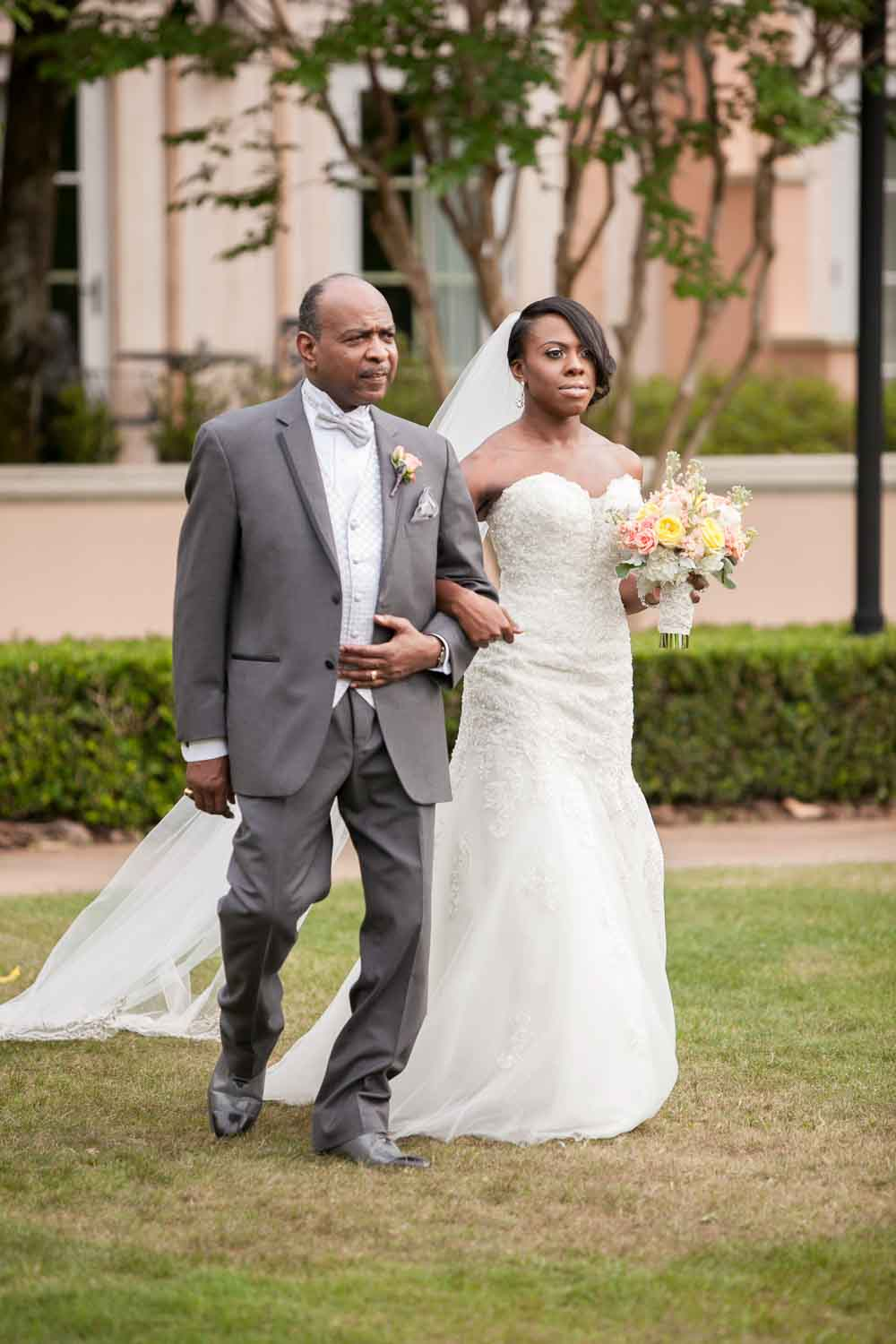bride and her father walking up wedding aisle