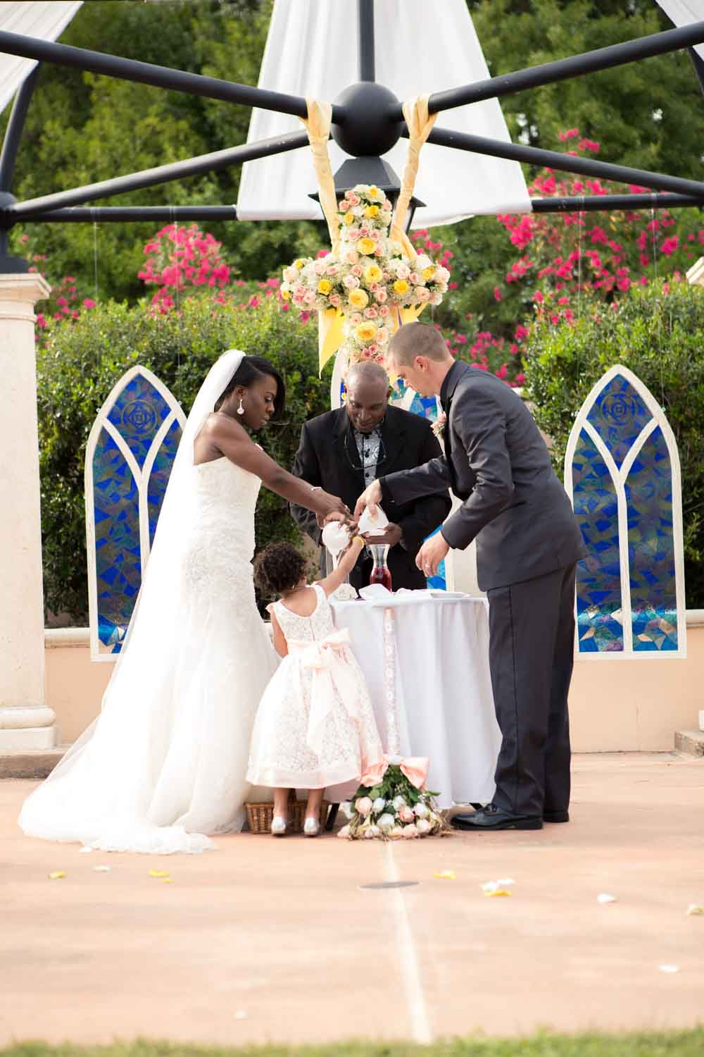 bride groom and daughter doing sand ceremony at Loews Portofino Bay wedding