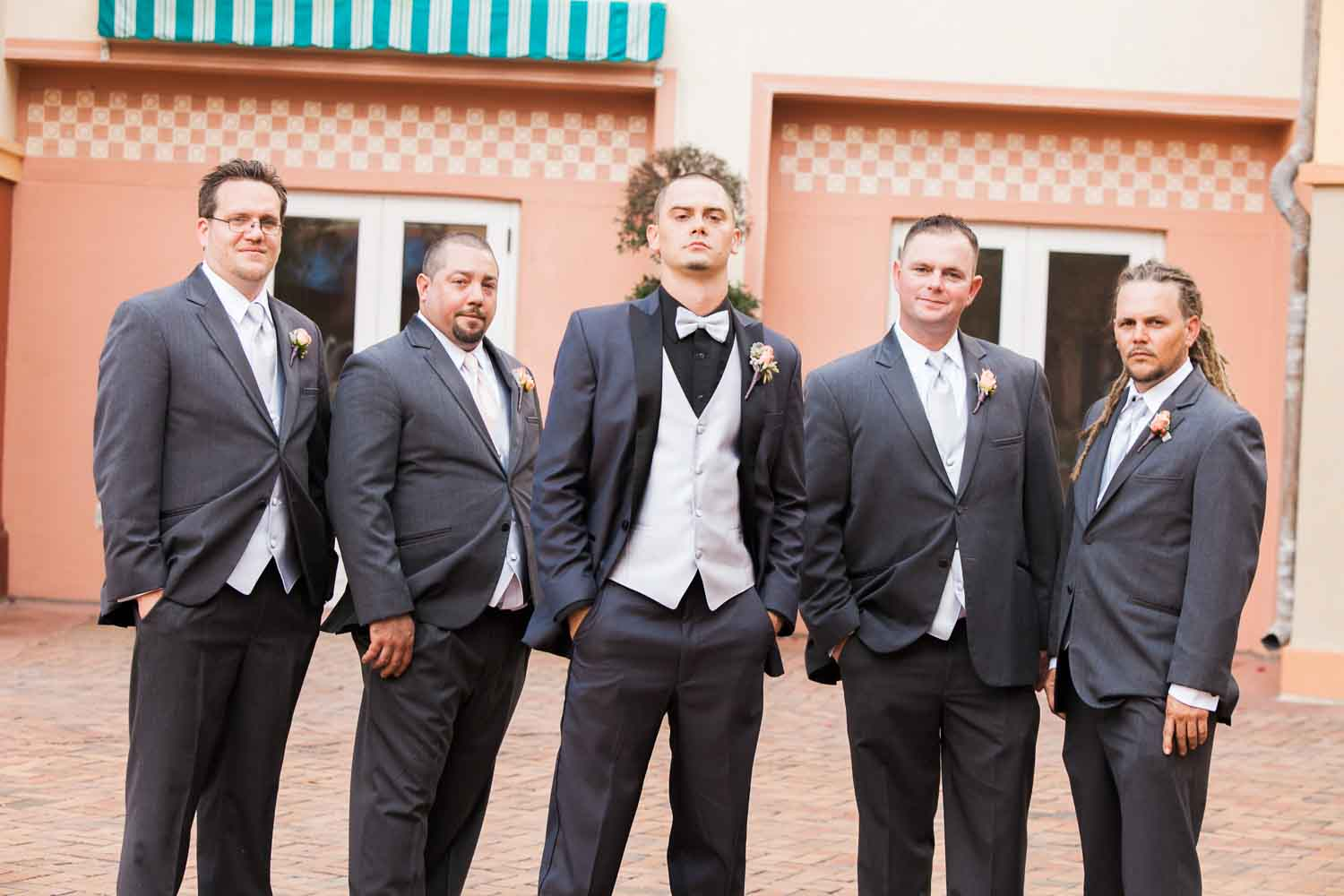 groom and groomsmen in black tux for wedding