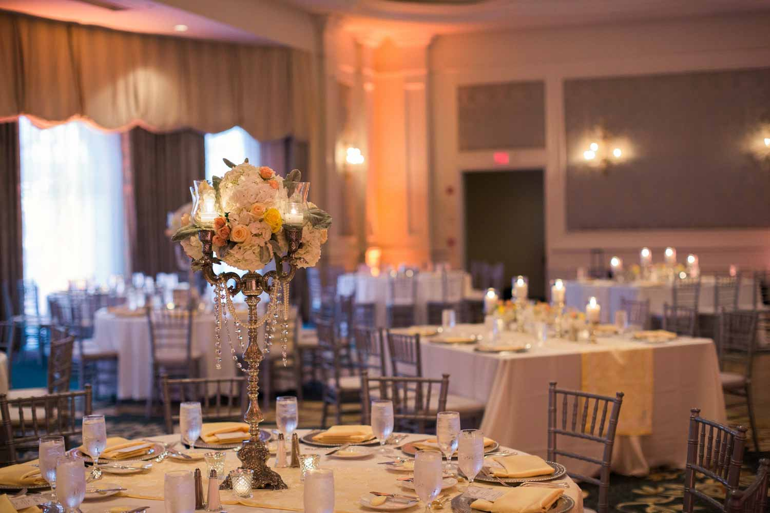 floral arrangement on wedding reception table