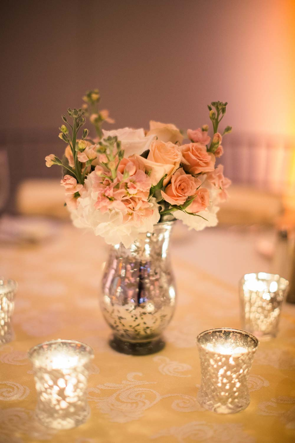 blush roses in mercury glass vase