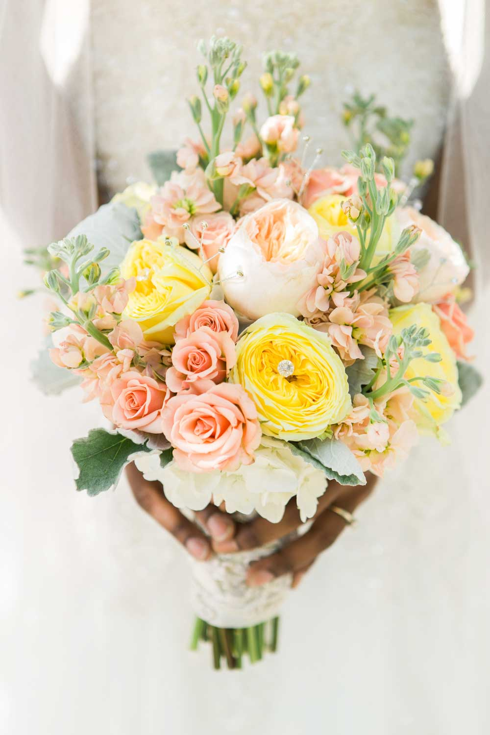 bride holding blush and yellow bridal bouquet