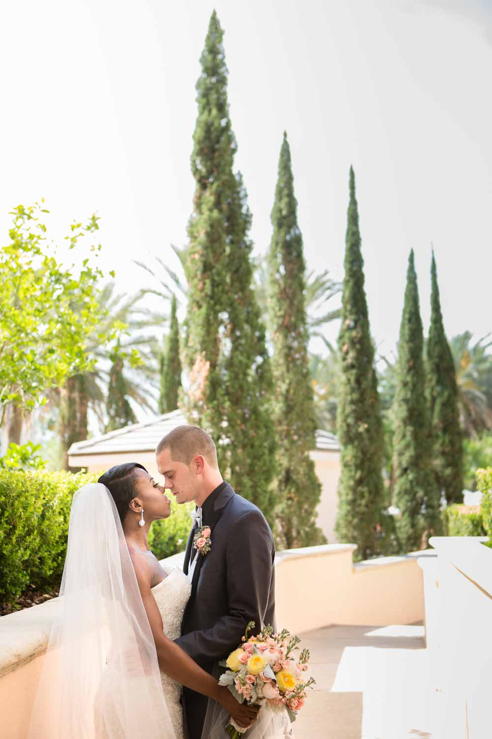 bride and groom in garden at Loews Portofino Bay in Orlando