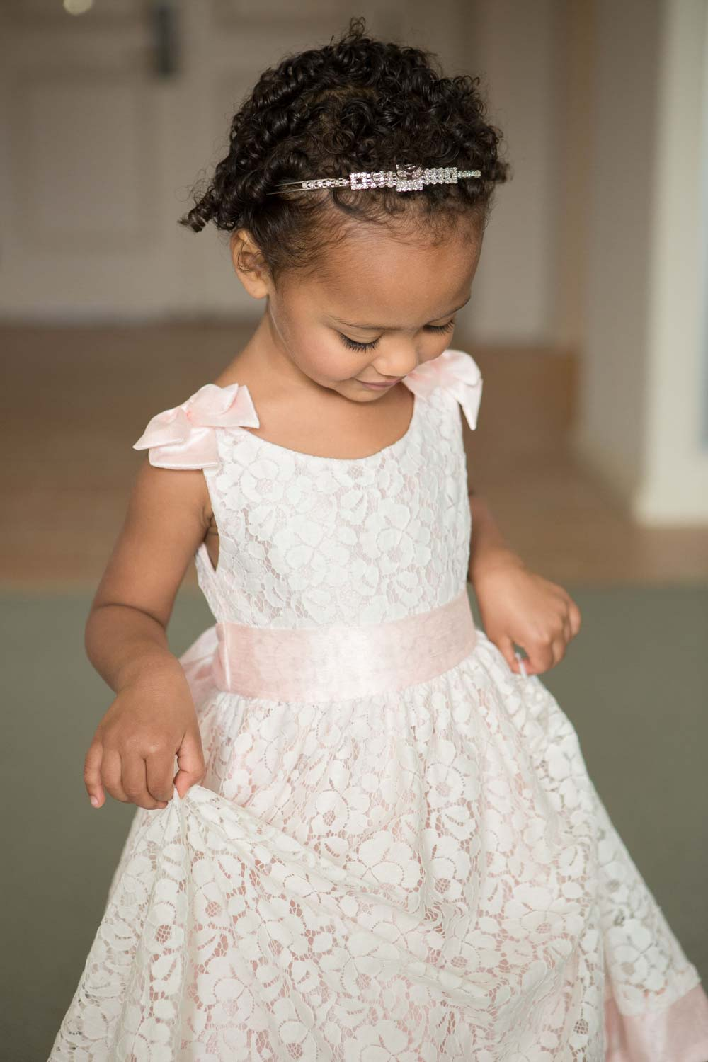 flowergirl in pink and white lace dress