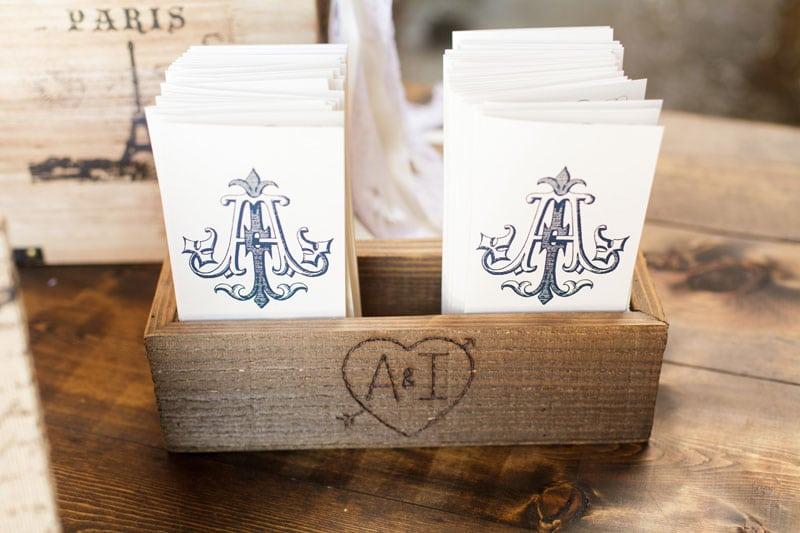 navy monogramed wedding programs in rustic box