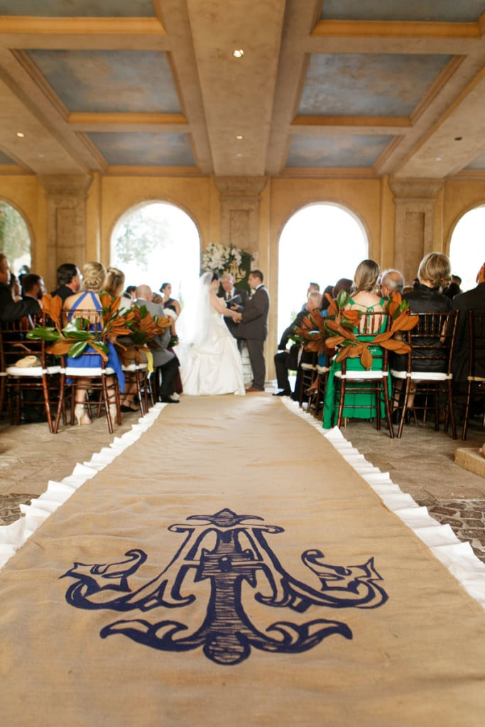 wedding ceremony at Bella Collina with monogramed aisle runner