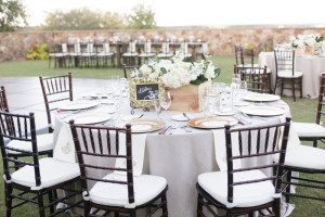 gold framed chalkboard table number with white floral centerpiece