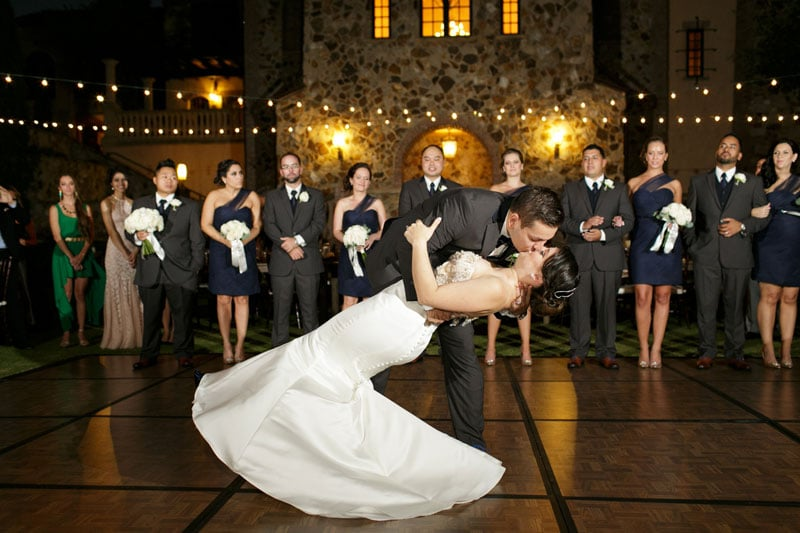 couple kissing on their wedding dance floor