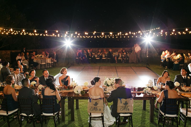 couple at sweetheart table in front of dance floor