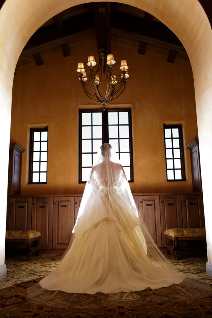 bride with veil looking out window for Bella Collina wedding
