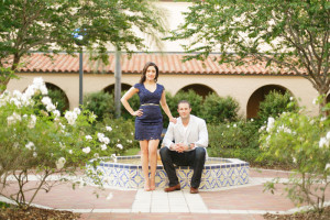 Couple standing in front of water fountain