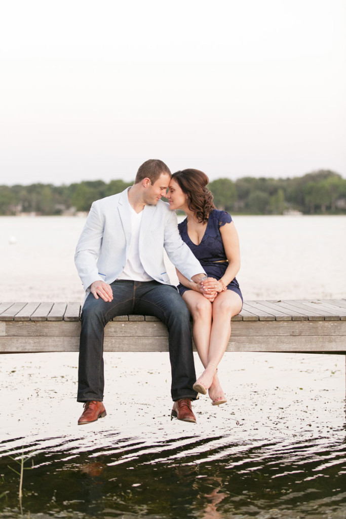 couple sitting on dock at Rollins College