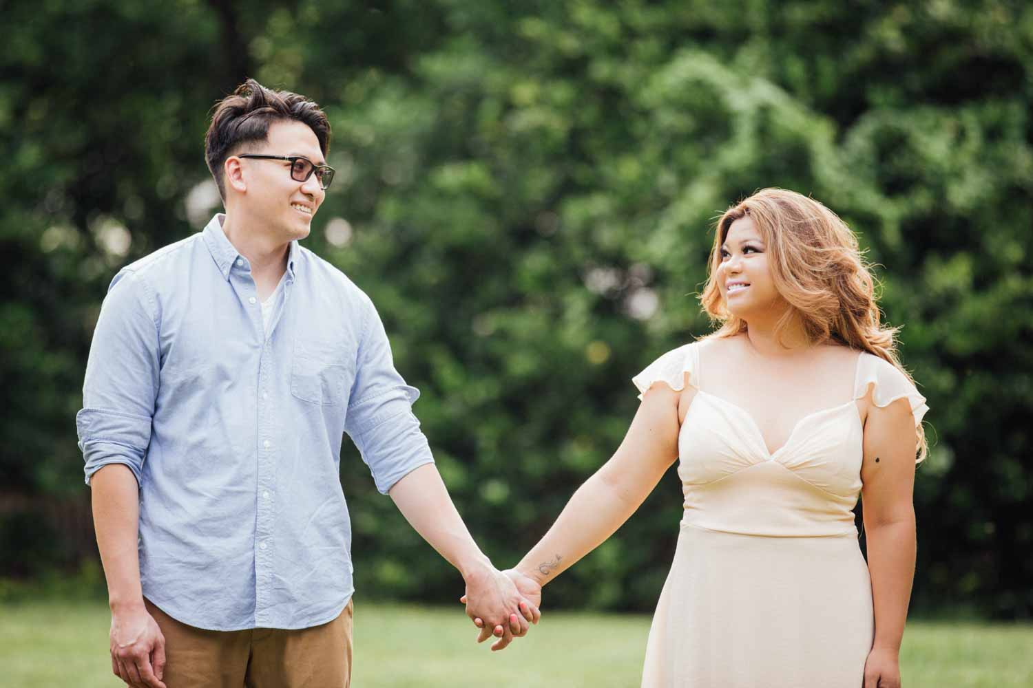 couple holding hands at their engagement session