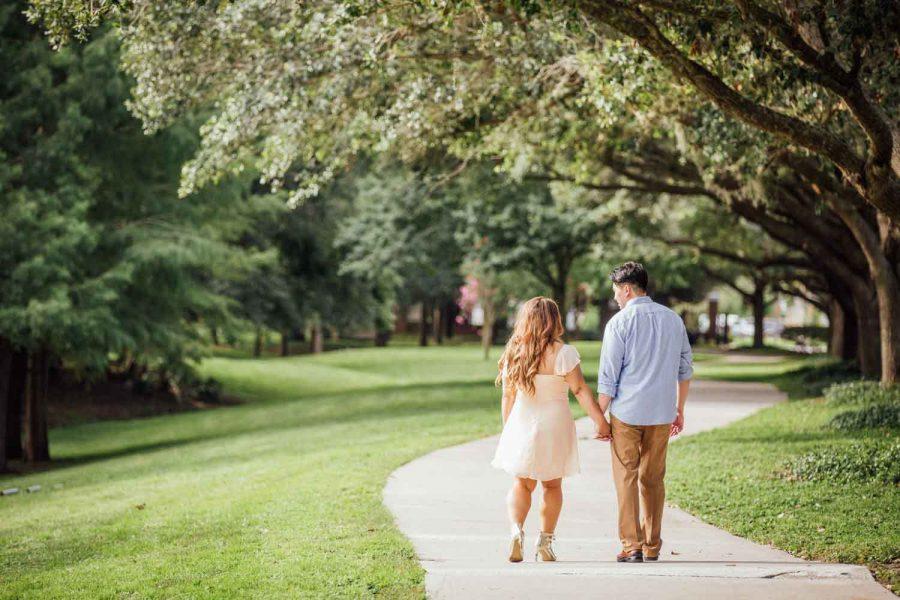 couple walking down winding sidewalk