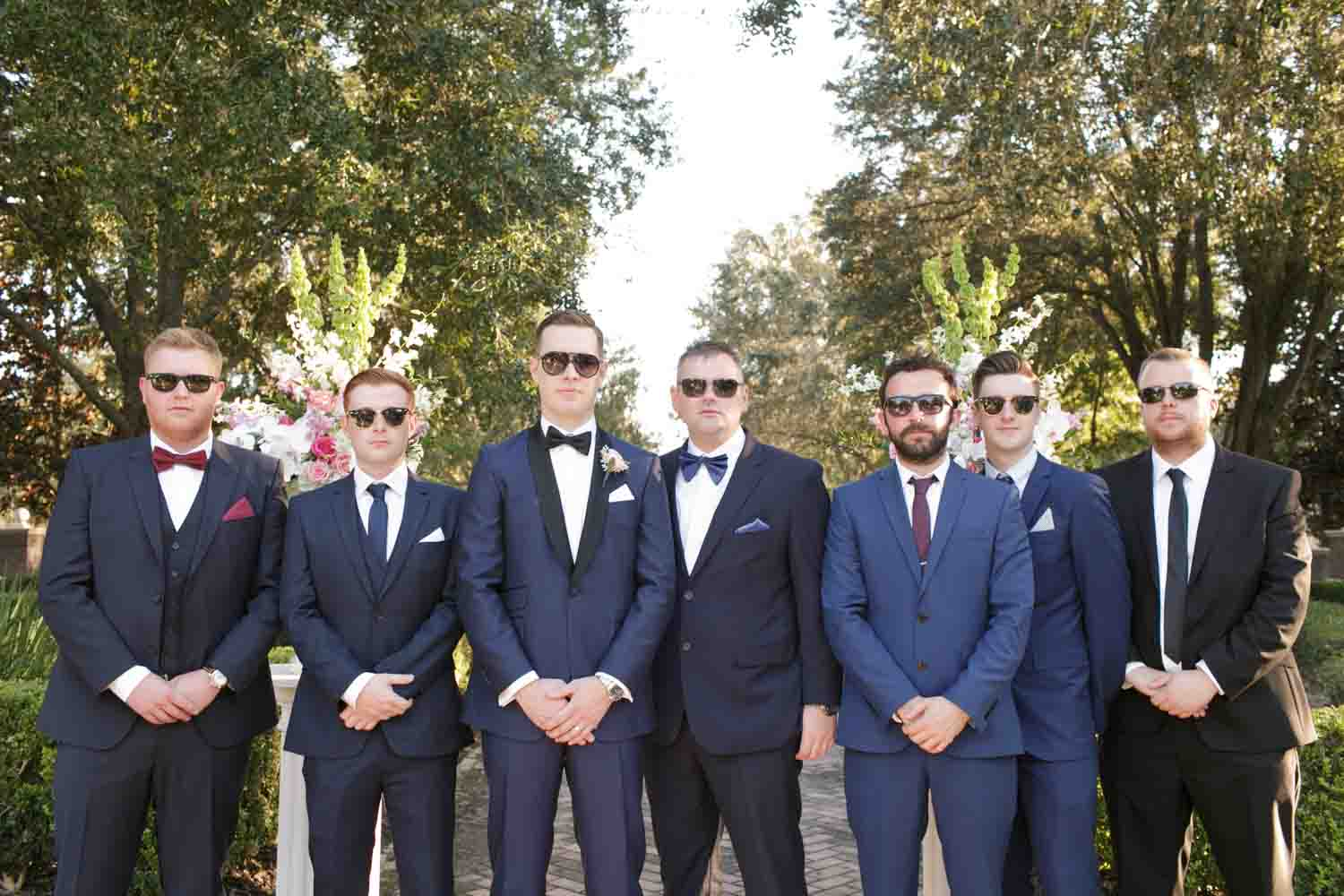groom and groomsmen in sunglasses and navy suits