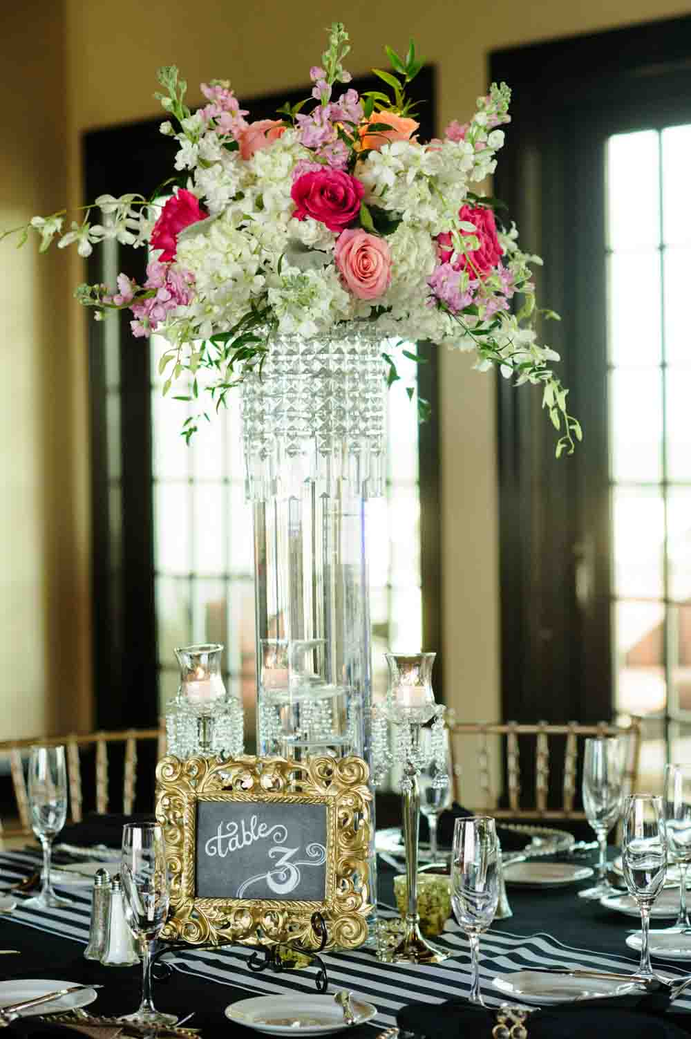 large crystal vase with fuchsia and pink flowers for wedding