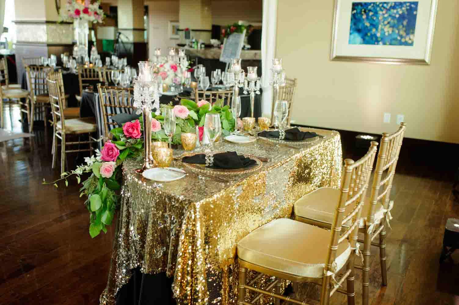 sweetheart table with gold sequin linens