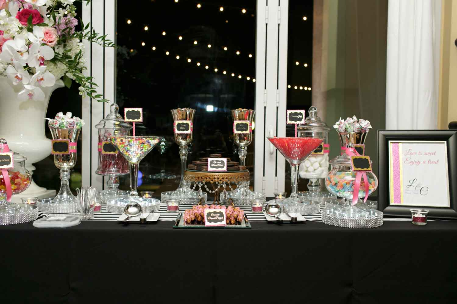 candy buffet on black linen in glass jars