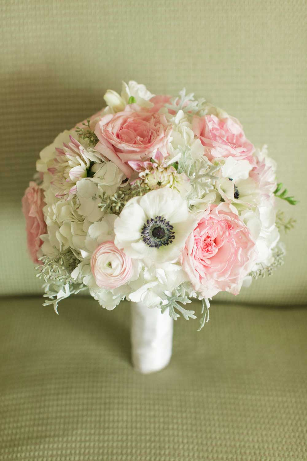 blush and white bridal bouquet on chair