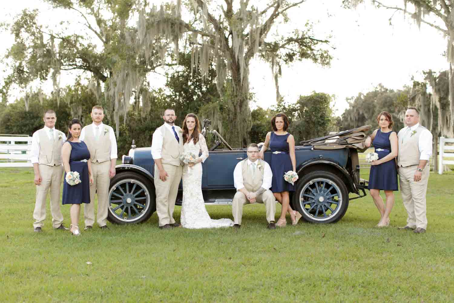 bridal party standing in front of vintage truck