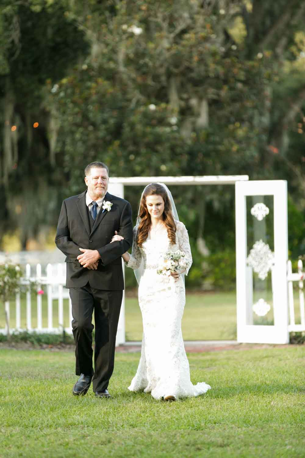 father walking bride up aisle for outdoor ceremony at Rocking H Ranch