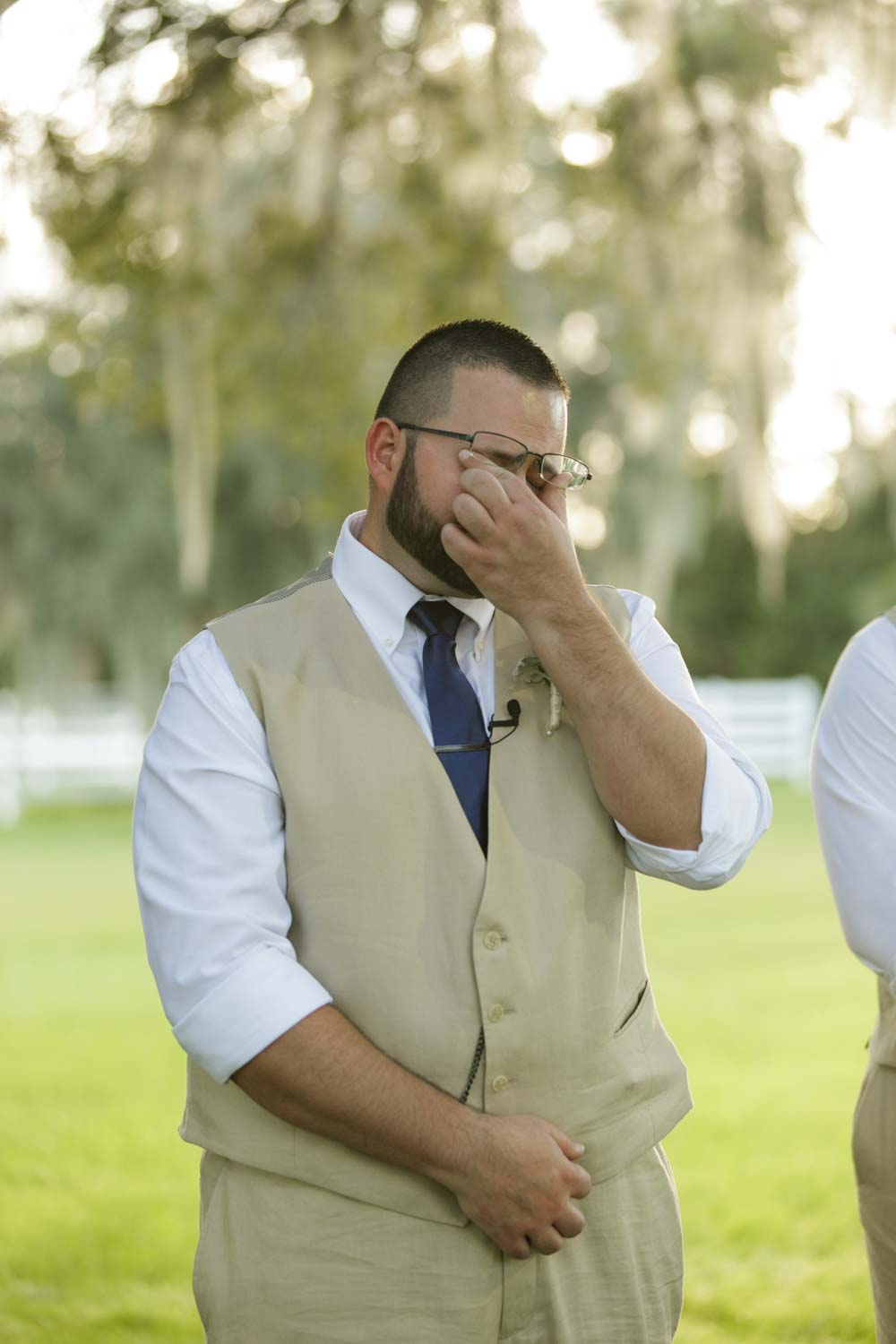 groom crying when seeing bride walk up aisle