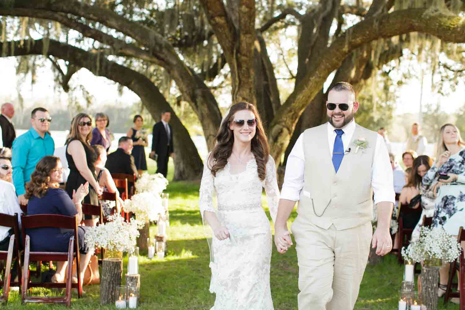bride and groom walking with sunglasses after getting married