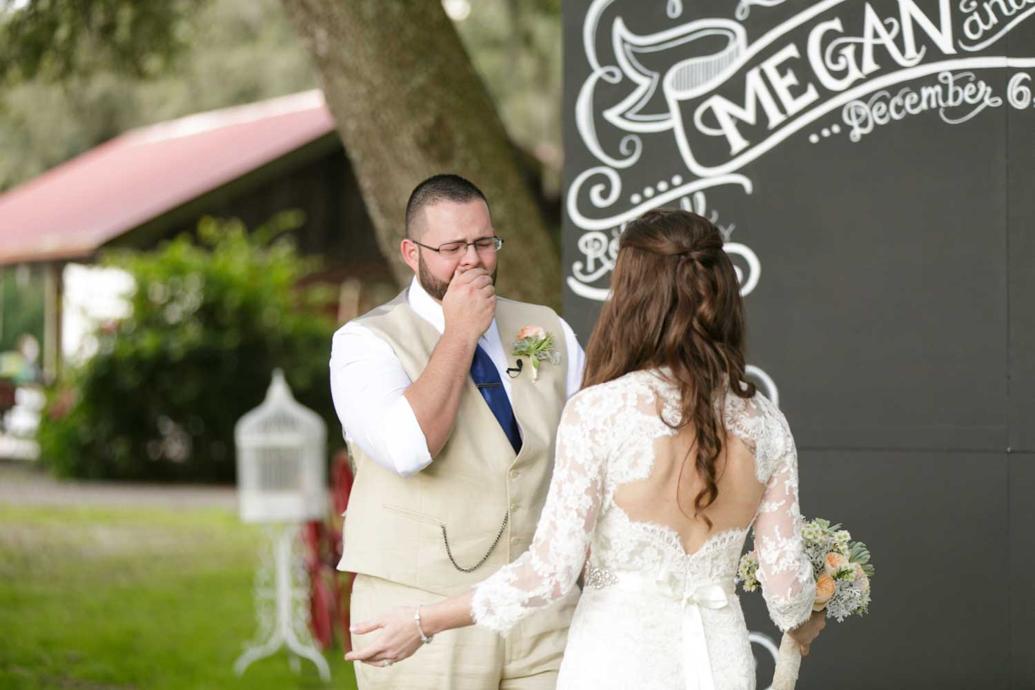 groom crying after seeing bride during first look
