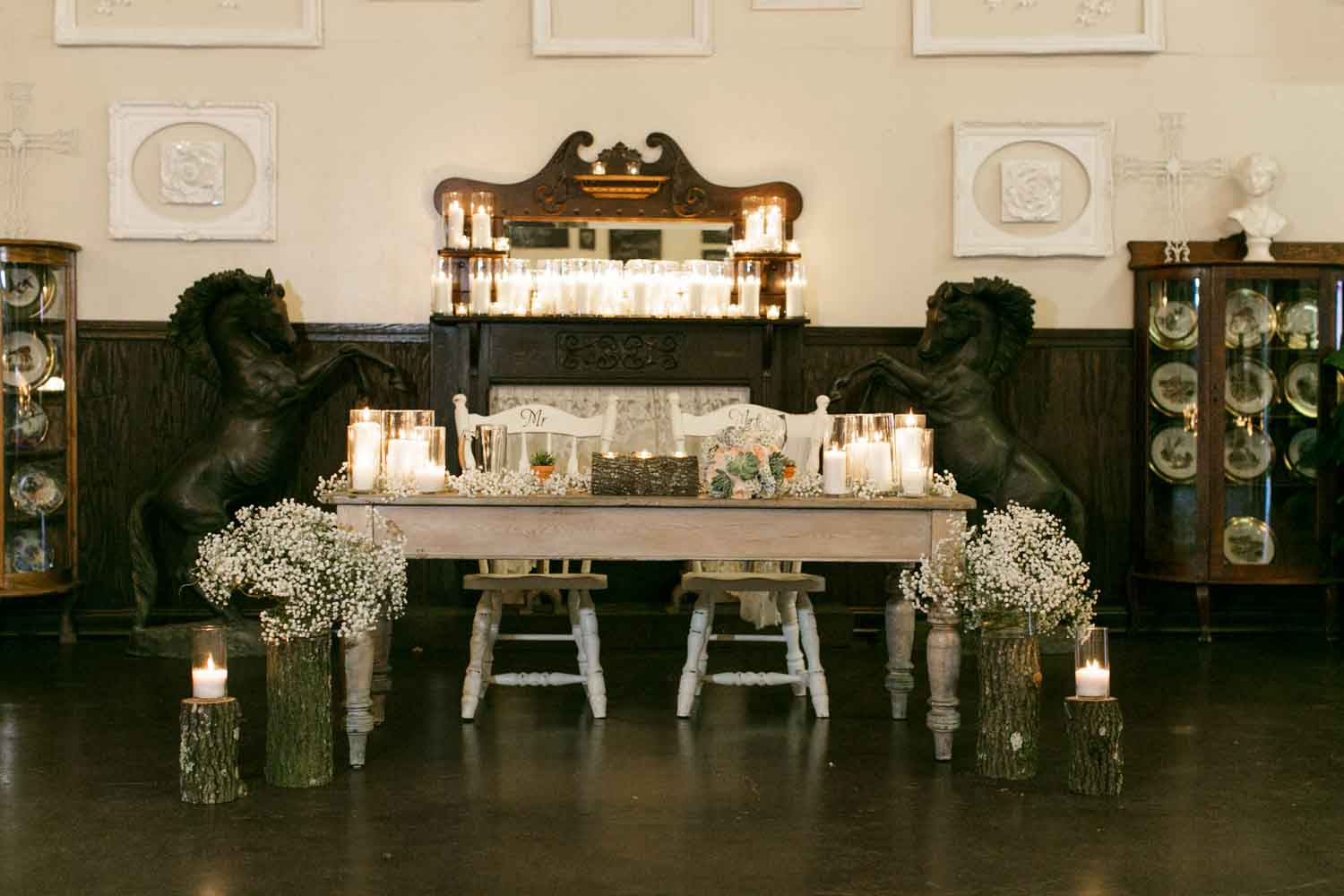 sweetheart table with baby's breathe and farmtable