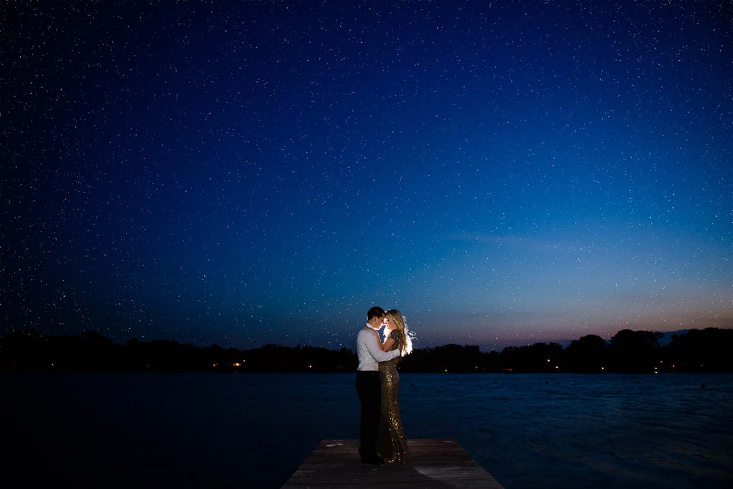 couple on dock at Rollin College at night