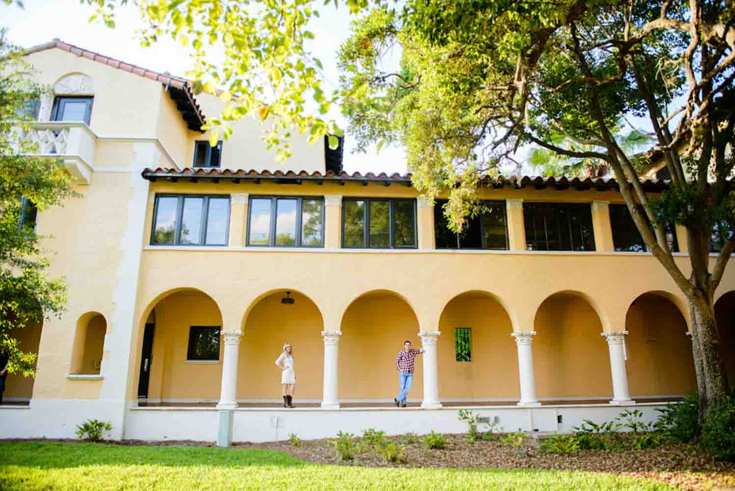 Couple standing in walkway at Rollins College