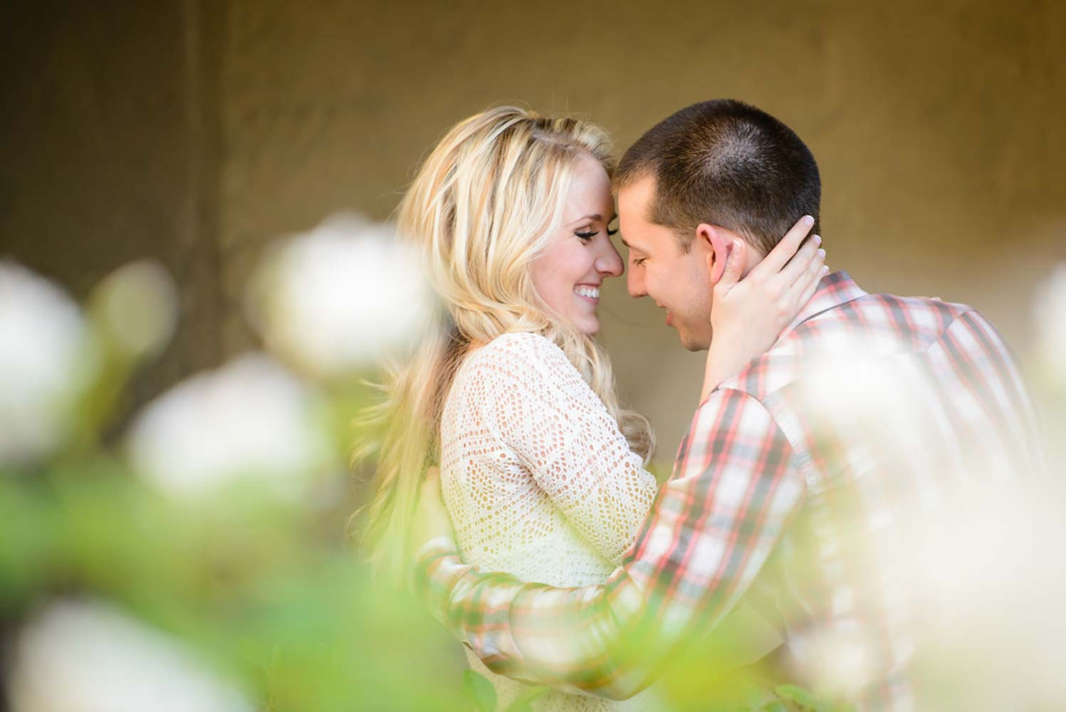couple hugging and smiling for engagement session
