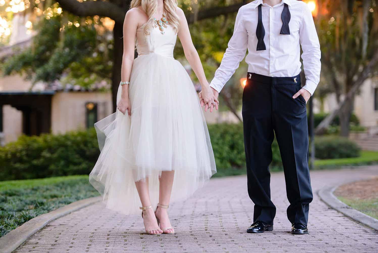 engaged couple on brick walkway