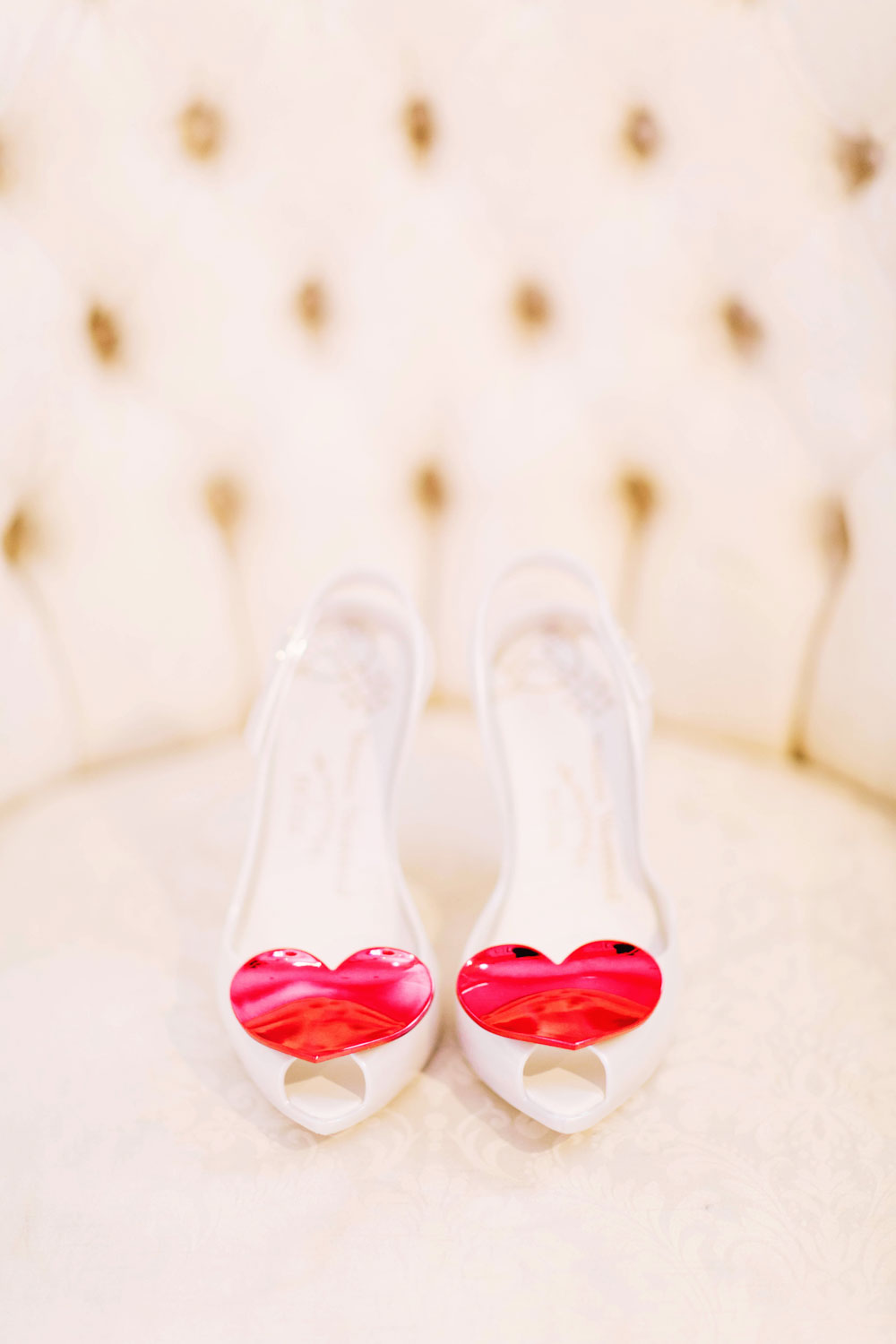 bridal shoes with red hearts on toes