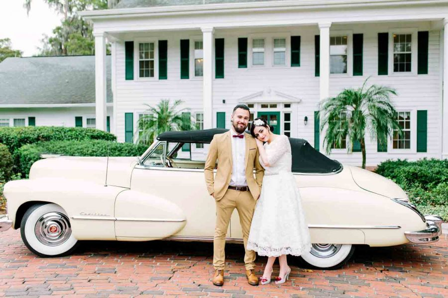 bride and groom in front of vintage car at Cypress Grove Estate House