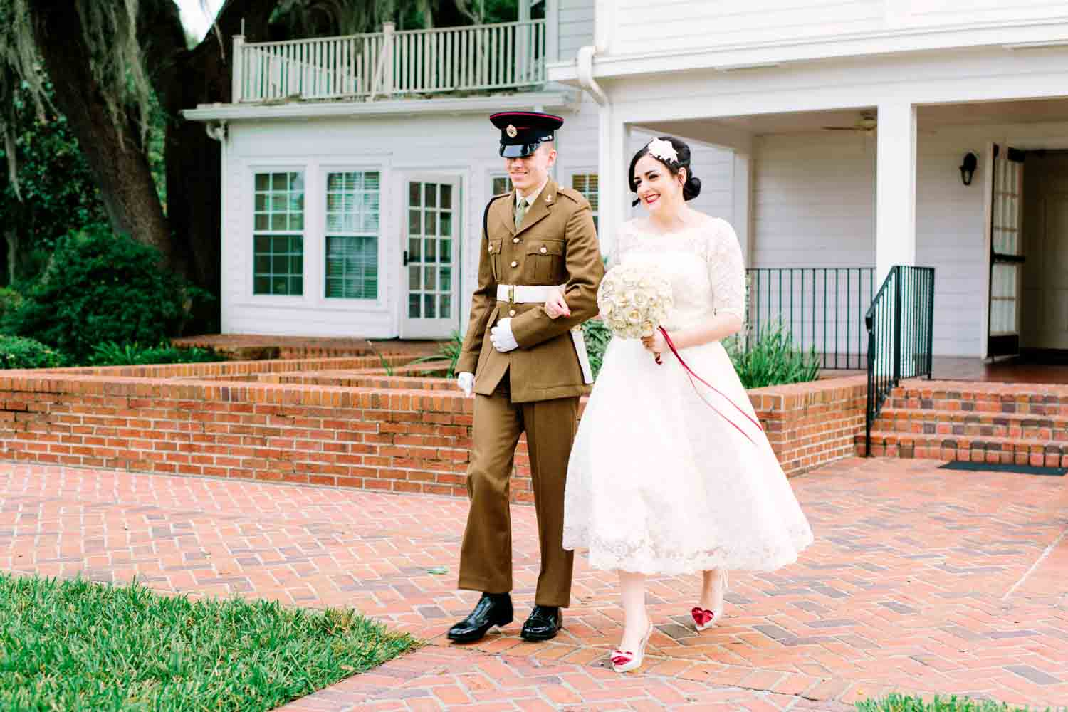 bride walking up brick paved walkway for wedding ceremony