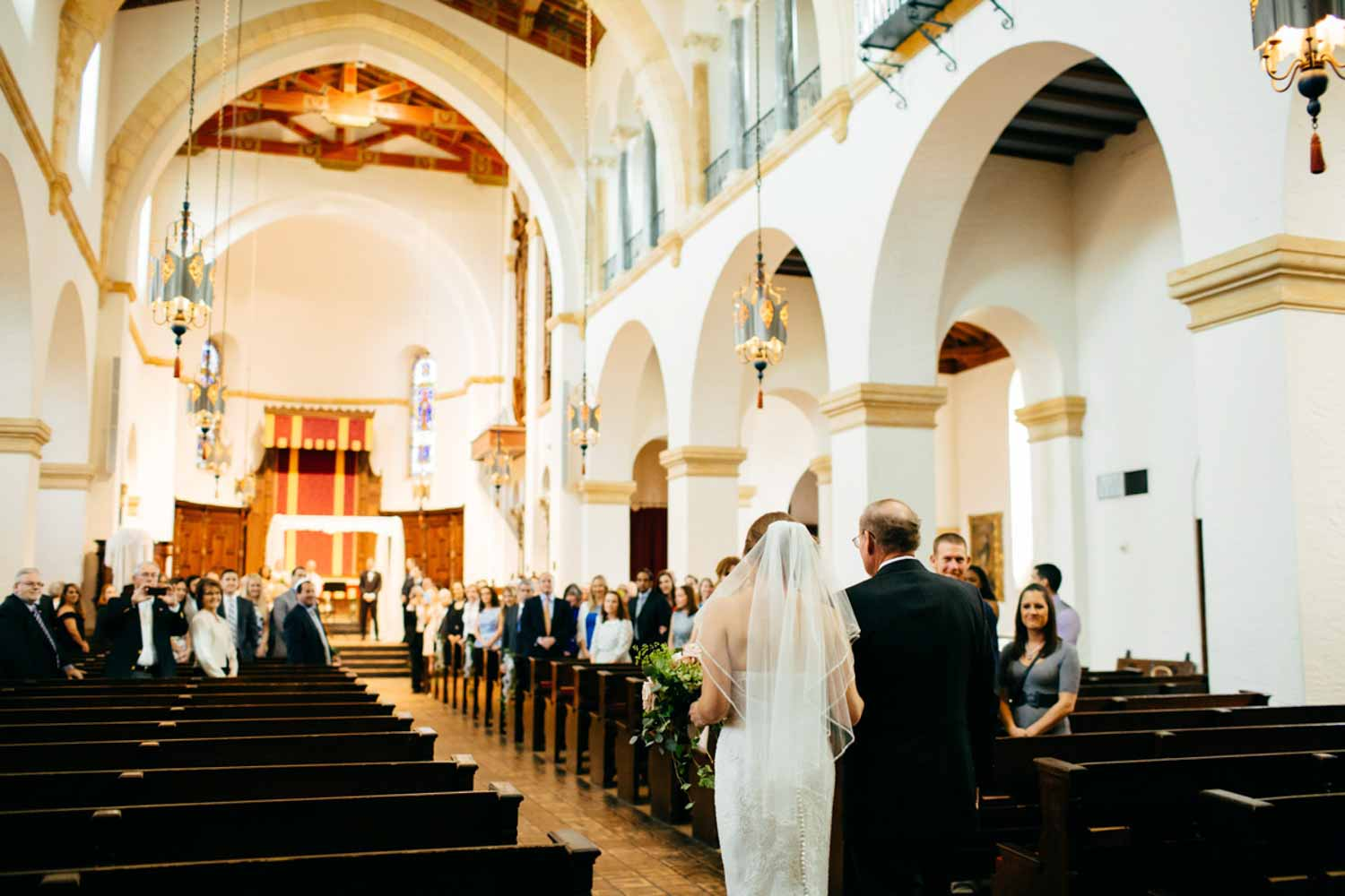 bride walking up aisle for Knowles Chapel wedding