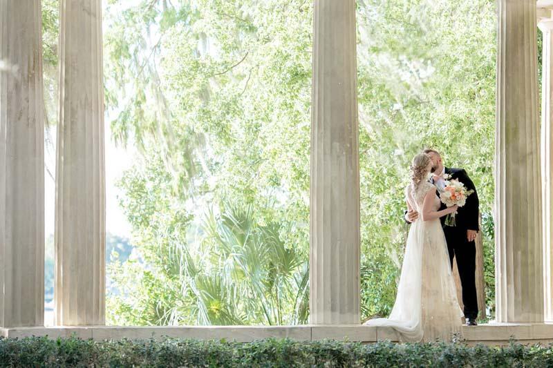couple kissing at ceremony space at Kraft Azaela Gardens