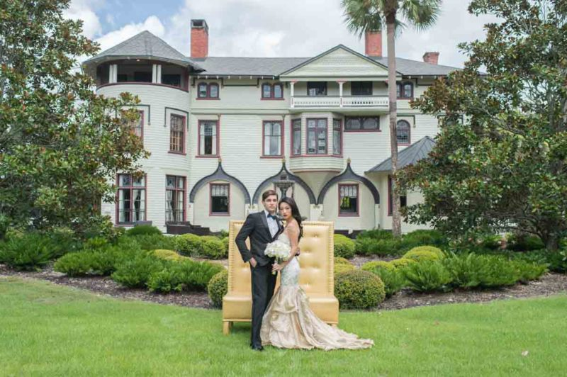 bride and groom in front of the Stetson Mansion