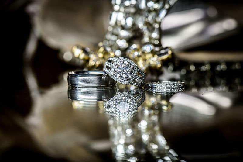 wedding rings on table for questions for your wedding photographer article