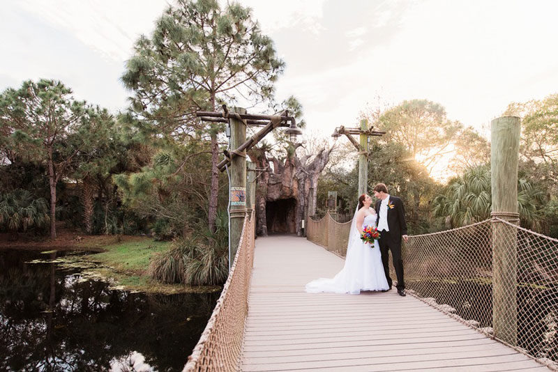 couple standing on bridge at the Brevard Zoo