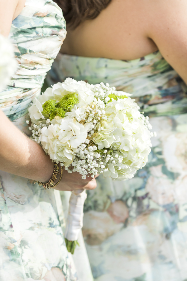 bridesmaid holding white and green bouquet