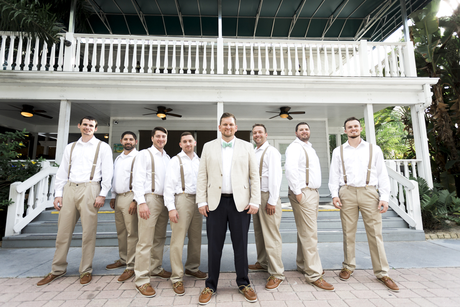 groom and groomsmen in beige suspenders