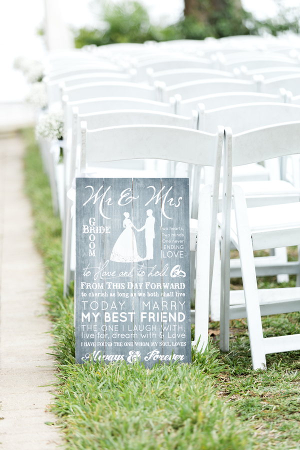 mr and mrs wedding welcome sign leaning on white chair