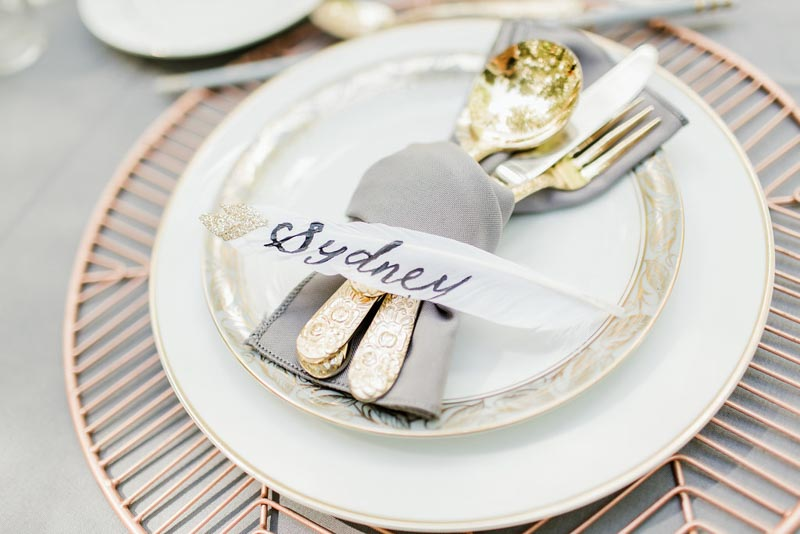 calligraphy escort card on feather